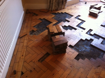 Floorboard and parquet wood block flooring restoration in for Wood floor knocking block