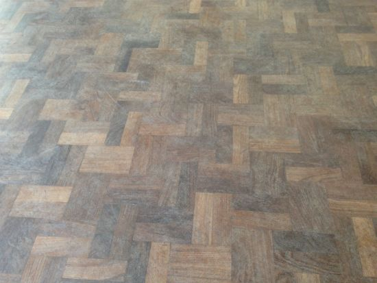 Close up of the Walnut Parquet Floor at Dewi Sant Primary School Rhyl