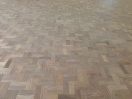 Close up of the Walnut Double Herringbone parquet floor prior to 1st sealer coat being applied
