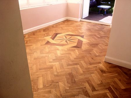 Rustic Oak Parquet Flooring With Marquetry insert Restored in Cheshire