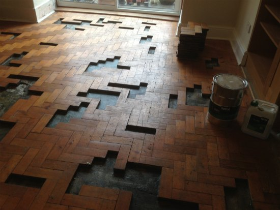 Parquet wood block flooring repairs how to repair parquet for Wood floor knocking block